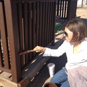 Lara Serbin painting the pickets
